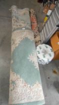 A quantity of Chinese rugs,