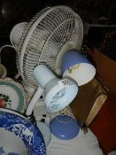 Two adjustable lamps and a fan.