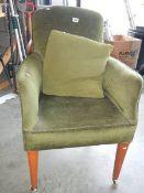 A green arm chair.
