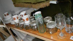 A shelf of vintage ceramics and glass ware.