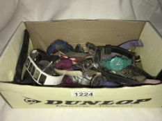 A box of wristwatches in various conditions