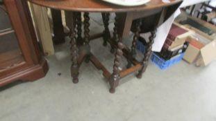 An oak gate leg table.