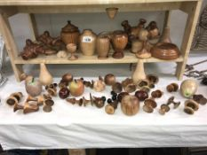 A large quantity of carved/turned wooden items including mushrooms, Teddy Bears & fruit etc.