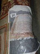 """A large rug, 8'6"""" x 6'8""""."""