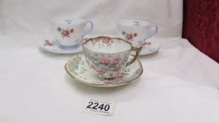 Two Shelley tea cups and saucers and an unmarked tea cup and saucer.