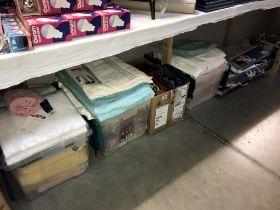 A large quantity of towels and bathmat sets,