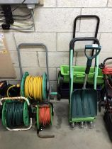 2 hose pipes on reels, an extension lead, 2 garden seed drills,