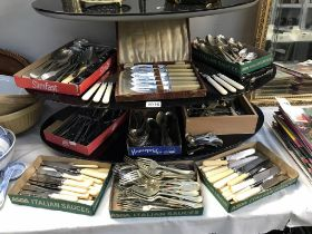 A large quantity of vintage cutlery and flatware