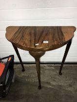 An Edwardian dark wood hall table on 3 Queen Anne legs (71cm x 37cm x 73cm high)