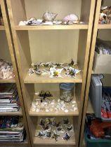 A large quantity of porcelain butterflies & sea shells etc.