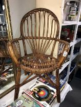 A vintage bamboo/cane arm chair