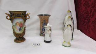 A Carlton ware vase, A Royal Worcester Nun candle snuffer,