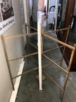An unsealed vintage wooden clothes airer & a window blind
