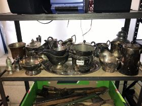 A quantity of silver plated metal ware including tea set, tray & gravy boats etc.