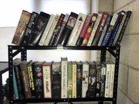 2 shelves of hardback books, various titles including Gilbert & Sillivan,
