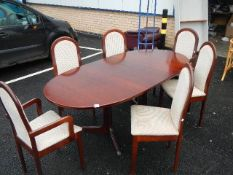 A mahogany extending dining table and 6 chairs.