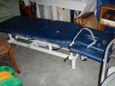 An electric massage table.