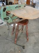 A Rexon scroll saw, works but needs attention and an old 4 leg stool.