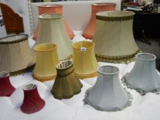 A mixed lot of mid 20th century lamp shades in various sizes, 12 in total.