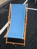 A vintage wood and canvas deck chair.