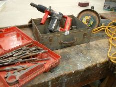 """A Hilti TE17 and a Black and Decker 9"""" grinder, both 110V and a box of masonry drill bits."""