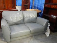 A grey leather 2 seat sofa in good condition.