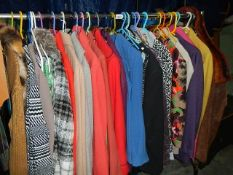 A large good lot of clothing including fur scarf, leather belts, suits etc.