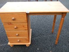 A 4 drawer pine dressing table.