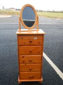 A pine 5 drawer chest and a pine mirror.