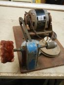 A vintage belt driven buffing machine, in working order.