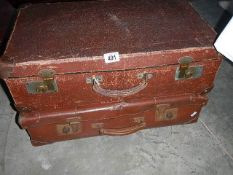 2 vintage suitcases containing vintage Christmas decorations.