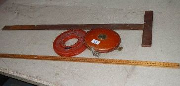 A vintage Rabone Chesterman leather tape, a tailor's yard stick,