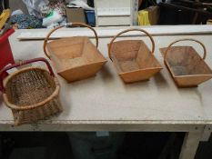 3 graduated matching pine garden trugs and a small wicker basket.