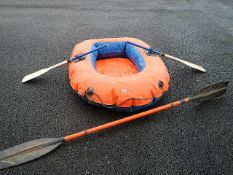 An Octopus III inflatable dinghy with oars.
