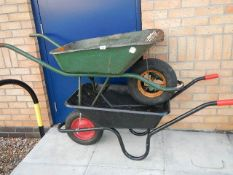 2 wheel barrows, one as new and one in good condition,.