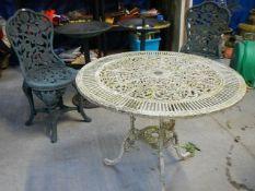 An aluminium garden table, 2 plastic bird baths and 2 plastic chairs.