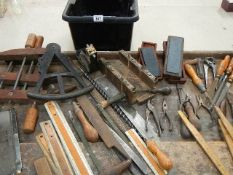 An interesting lot of joinery items including wooden clamps, oil stones, rules etc.