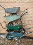 4 wheelbarrows in various conditions.