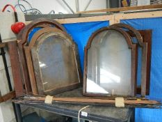 A large collection of clock fronts and a large lot of pendulum feathers and arms etc.