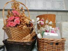 A mixed lot of small wicker baskets with small plastic trays, cup mats and handkerchiefs.