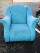 A blue fabric arm chair in good clean condition.