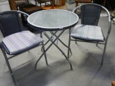 A glass top garden table and 2 chairs,.