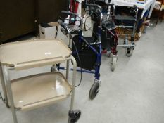 4 mobility aids - 3 collapsible shopping trolleys and a household trolley.