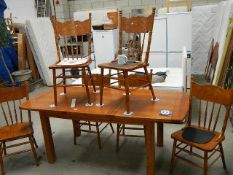 A good quality solid oak extending dining table with 6 chairs,.
