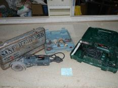 """A Bosch impact drill and a 4"""" grinder, both working."""