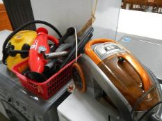 A Morrison's cylinder vacuum cleaner, a steam buddy, one other item and accessories.