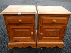 A pair of pine bedside cabinets.