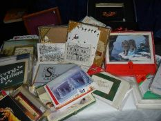 A large quantity of new/unused Christmas cards and decorations.