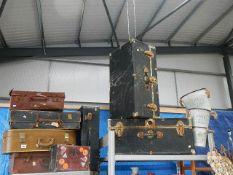 8 vintage suitcases/ trunks.