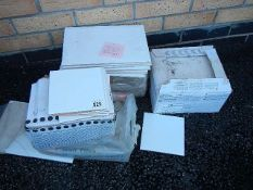Approximately 3 square metres of 20 x 30 cm white ceramic tiles and approximately 1 square metre of
